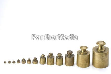 brass weights on white background