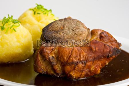 traditional bavarian roast pork with dumplings
