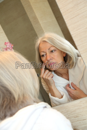 moisturizer applying bodycare facial old woman
