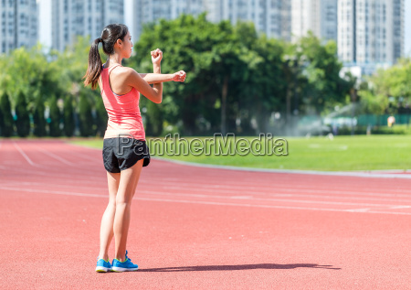 back view of sport woman stretching